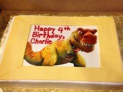 Yellow T-Rex cake