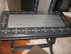 vanity painted black, with gold and silver- and a stencil to complete