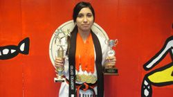 04/03/2011 Championship Assistant instructor Dennise Bartra 1st place forms 1st place breaking 1st place weapons 1st place fighting 1st place Grand Champion Womens Division