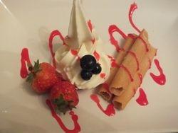 ice cream Cookie rolls dessert with fruit and raspberry sauce
