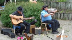 Metis fiddler and Guitar players