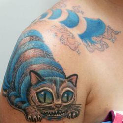 At last, finished up Heather Hosler's Slowly Disappearing, but ready to Pounce, Cheshire Kitty smile emoticon This is just the beginning of a Fun Alice and Wonderland Sleeve.