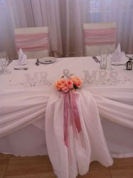 White head table swag with pink.