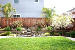 pond with cascading waterfall, block retainin wall
