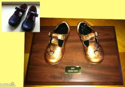 Pair of shoes mounted with nameplate