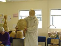 Ancient beekeeper with skep