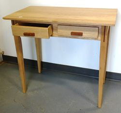 "Two-drawer table: 31""H x 33""W x 19""D  $110.00"