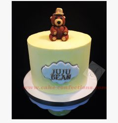 Yellow Buttercream Cake with Bear Topper