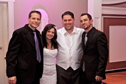 Jimmy and Jay with a happy bride and groom
