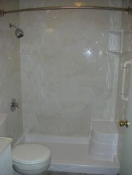 After: Seated shower with Almond White Marble walls