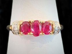 Three stone ruby ring with diamonds