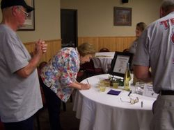 Dianne Williams tries to guess number of wine corks in jar