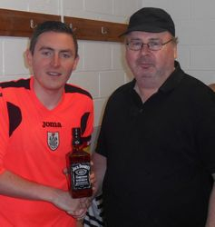 ALAN GALINDO RECEIVES A BOTTLE AFTER MAKING HIS 100TH APPEARANCE