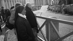 A nun admiring a Nativity display, Rome