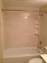 After: Almond White Marble Subway Walls w/ White tubliner.