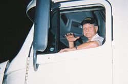Charles waving in his J.B. Hunt truck