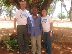 Eric and Mimi with Gallus Kalollo, the retired water technician responsible for much of the technical design of the Pommern Water Project