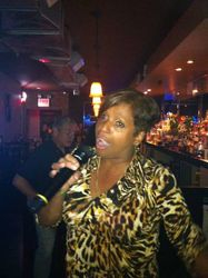 Mara bringing her energy and singing style to 502 Bar Lounge's Social Saturday Karaoke Night!