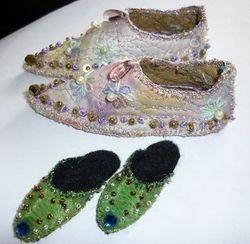 Teeny tiny slippers