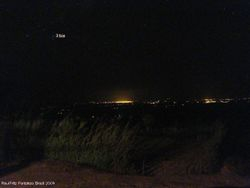 Distant view (city lights and the Scorpius constellation)