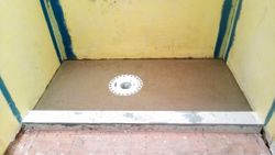 Mortar bed shower tray, vertical Schluter Kerdi Drain