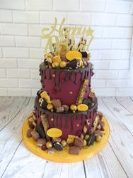 70th birthday claret and gold drip cake