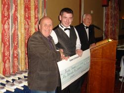 Jonny Sweeney presents cheque to Newry Hospice on behalf of the Sweeney Family