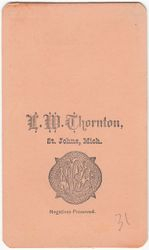L. W. Thornton, photographer, of St. Johns, MI - back