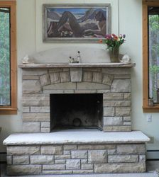 Faced Buff  Stripstone fireplace Nederland with Cross Canyon accents