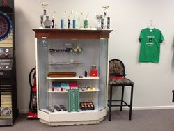 Pool supply cabinet with trophies