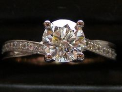 18ct White gold diamond solitaire with pave set brilliant cut twist shoulders.