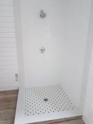 custom shower base with mosaic