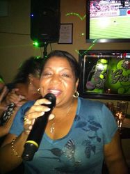 Irma bringing that tropical flavor to the crowd at Legendary Friday Night Karaoke!