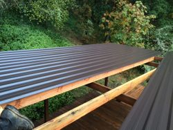 Metal roof over large deck going down