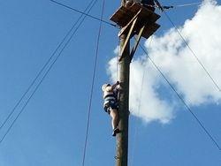 Logan climbs to zip line platform