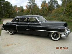 6. 52  Cadillac series 75 limo.