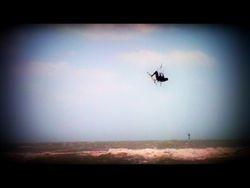 Kiteboarding air above the surf, Siesta Key, Florida