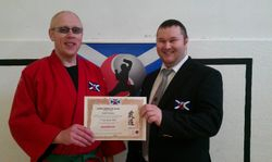 Presentation to Joe Sweeney of 5th KYU Kempo on behalf of Soke Gunter Bauer