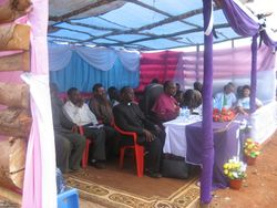 Bishop Mdegella presides at the ceremony, joined by guests from the community, Roman Catholic and Lutheran churches, Water District, and many others
