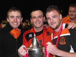 Holding the Championship Trophy with Carrick captain Glenn Taggart