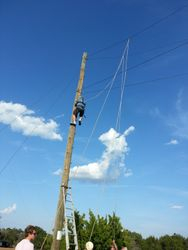Michael climbs pole for partners ropes