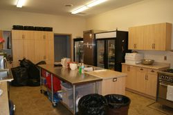 kitchen showing fridges and work prep