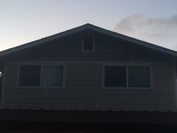 Fiber cement staggered shake in the front gable