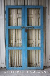 #22/214 Pair Wooden Doors with Iron Bars