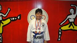 Giovanni Ballardo won 3rd place in fighting 3rd place in forms