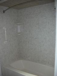 After: Brecchia Surround with grab-bar & tub liner