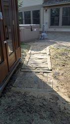 Stone walkway to hot tub from sauna