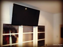 "55"" Flat screen TV installed over the closet doors"