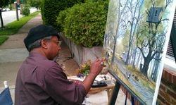 Dexter paints in front of studio