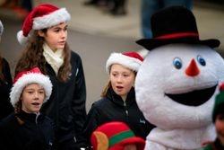 Cast members Eliza, Megan, and Emily at the Santa Parade